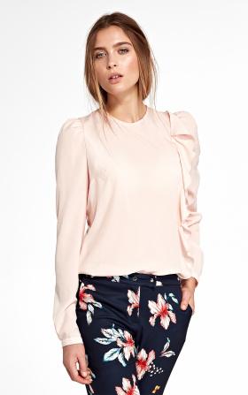 Różowa bluzka z pionową falbanką po lewej stronie