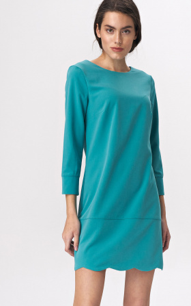 Turquoise dress with a neckline at the back