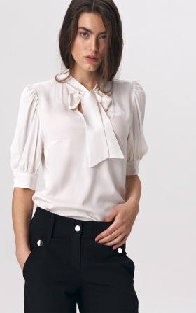 Elegant ecru blouse with a tie on the neckline