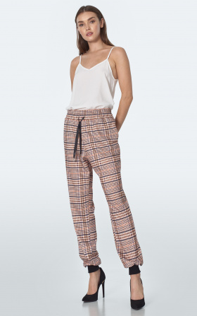Beige tracksuit pants in checkered pattern