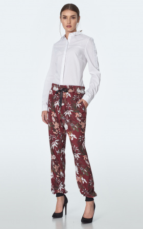 Burgundy tracksuit pants in flowers pattern