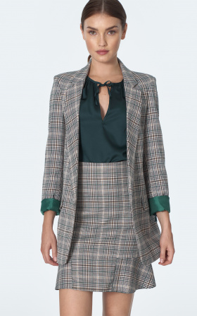Mini skirt with frill in chequered green