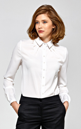 Delicate ecru blouse with ruffle at the collar